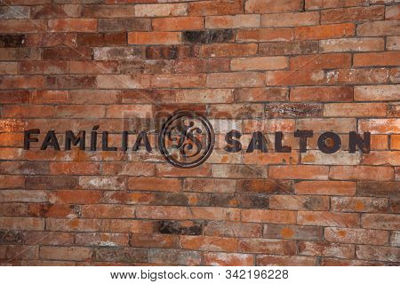 Bento Goncalves, Brazil - July 10, 2019. Sign On Brick Wall With The Brand Salton Family In The Salt