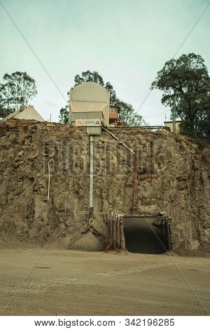 Bento Goncalves, Brazil - July 13, 2019. View Of Rocky Escarpment And Equipment In A Quarry Facility