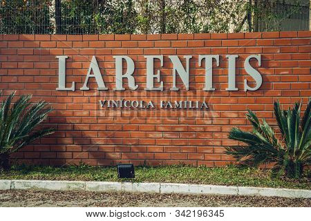 Bento Goncalves, Brazil - July 13, 2019. Outer Bricks Wall With The Company Sign Of Larentis Winery,