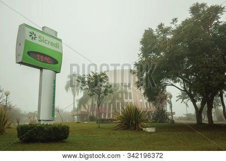 Bento Goncalves, Brazil - July 14, 2019. Placard With The Temperature And Saint Benedicts Church In
