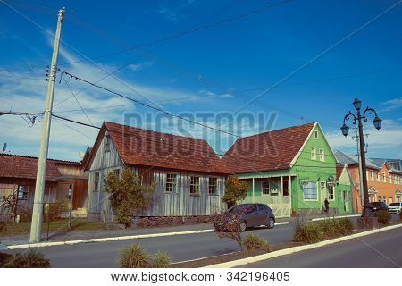 Cambara Do Sul, Brazil - July 19, 2019. Wooden Old Houses In Getulio Vargas Avenue, The Main Street
