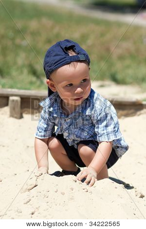 the boy in a sandbox