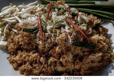 Asian Eating Food, Close-up Of Mee Grob Is An Sweet And Sour Crispy Noodles, Made From Thai Rice Noo
