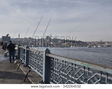 Istanbul, Turkey - December 2019. Fishermen Catch Fish At Galata Bridge