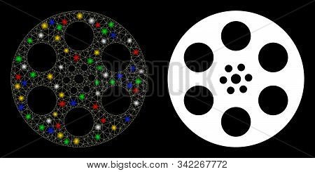 Bright Mesh Reel Icon With Glow Effect. Abstract Illuminated Model Of Reel. Shiny Wire Frame Triangu