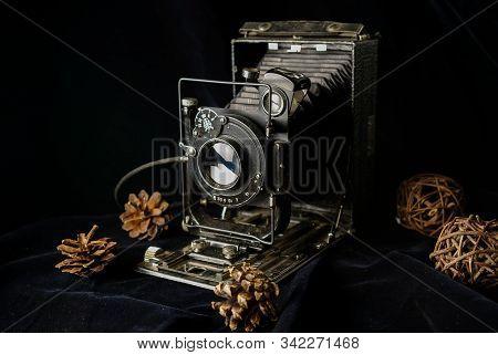 Old Retro Film Camera, Black, On Dark Velvet Fabric In Low Key