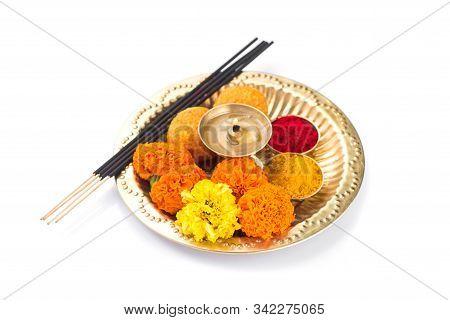 Beautifully Decorated Pooja Thali For Festival Celebration To Worship, Haldi Or Turmeric Powder And
