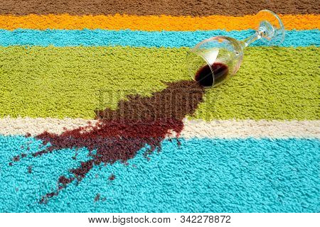 Spill Of Red Wine Over The Carpet