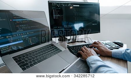 Programmer Working On Computer In It Office Typing Data Coding In Software And Checking Code On Comp