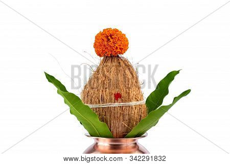 Copper Kalash With Coconut And Mango Leaf With Floral Decoration On A White Background. Essential In