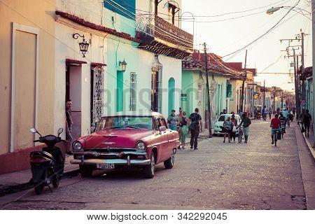 Trinidad, Cuba - December 16, 2019: Colorful Houses And Vintage Cars In Trinidad, Cuba. Unesco World