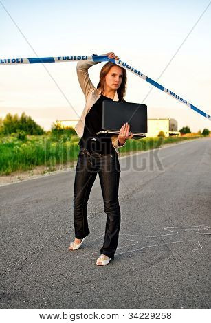 Young Criminalist With Laptop Crossing Police Tape