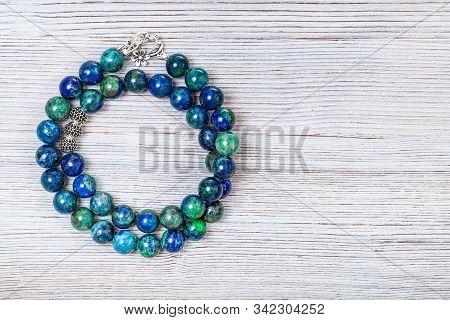 Needlecraft Background - Handcrafted Necklace From Polished Azurite Gemstones On Gray Wooden Board W