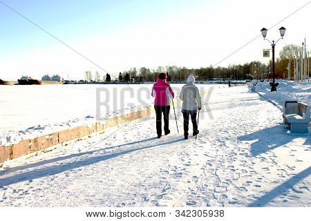 Petrozavodsk, Russia-february 13th, 2019: Middle-aged Women Walk Along The Snow-covered Promenade Wi