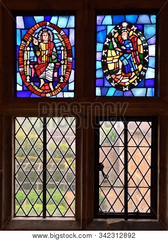 Upper Dicker, East Sussex, England - May 17 , 2019: Stain Glass Window In Mitchelham Priory Upper Di