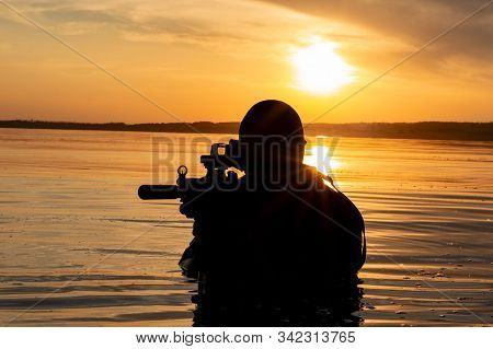 Fighter Of A Special Unit Leaves The Water And Prepares For The Start Of The Operation. The Concept
