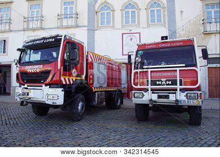 Faro, Portugal - December 28, 2019: Portuguese Man And Iveco Fire Truck.