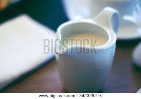 Milk In A Milk Jug On A Table, Close Up