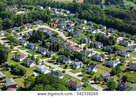 Aerial view of pleasant middle class suburban homes and streets near Atlanta Georgia.