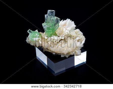 Green Apophyllite Crystals Mineral On Black Background