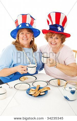 Patriotic conservative American voters sitting down to an actual tea party.  White background