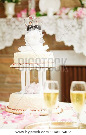 Wedding cake with two grooms on top, for gay marriage ceremony.