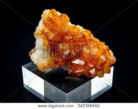 Citrine Quartz Crystals Mineral On Black Background