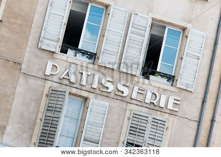 Sign Of Local Patisserie (french Bakery) Specializing In Pastries And Sweets In Typical Building In