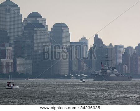 HOBOKEN, NJ - MAY 23: USS Gonzalez (DDG 66) goes past the World Trade Center in Lower Manhattan during the Parade of Sails on May 23, 2012 in Hoboken, NJ. The parade marks the start of Fleet Week.