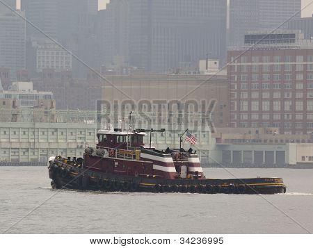 HOBOKEN, NJ - MAY 23: The tugboat Ellen McAllister travels on the Hudson River near  Manhattan during the Parade of Sails on May 23, 2012 in Hoboken, NJ. The parade marks the start of Fleet Week.