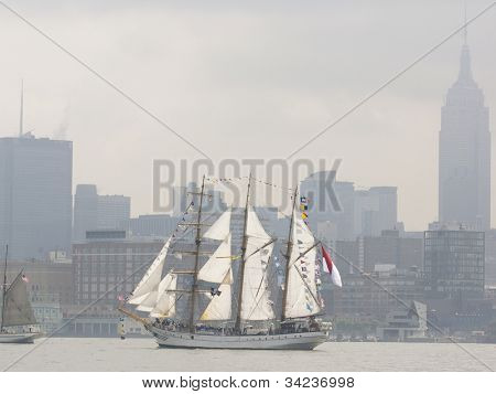 HOBOKEN, NJ - MAY 23: Tall ship KRI Dewaruci (Indonesia) sails past the Empire State Building during the Parade of Sails on May 23, 2012 in Hoboken, NJ. The parade marks the beginning of Fleet Week.