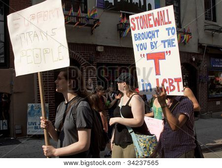 NEW YORK - JUNE 22: Supporters march past the legendary Stonewall Inn, known as the birthplace of the modern Gay Rights movement on the 8th Annual Trans Day of Action on June 22, 2012 in New York.