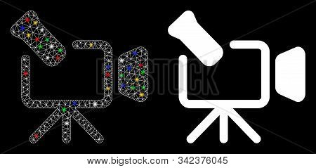 Bright Mesh Camcorder Icon With Lightspot Effect. Abstract Illuminated Model Of Camcorder. Shiny Wir