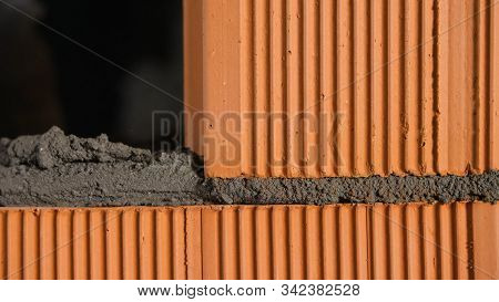 Bricklayer Tapping Down A Block Wall. Stock Footage. Construction Worker Knocks On A Brick With A Ma