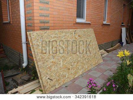 Oriented Strand Board (osb) Near Brick House Wall