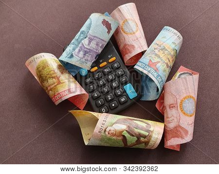Black Calculator And Costa Rican Banknotes Of Different Denominations