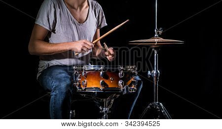The Drummer Plays The Drums. The Process Of Playing A Musical Instrument. The Concept Of Music.