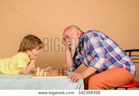 Chess Competition. Cute Boy Developing Chess Strategy. Childhood And Board Games. Grandfather And Gr