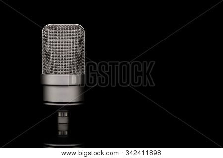 Mic - Close-up Of Professional Condenser Microphone On A Black Isolated Background. Large-diaphragm
