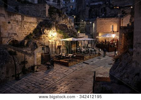 Matera, Italy - September 14, 2019: Evening View Of The City Of Matera, Italy, With The Colorful Lig