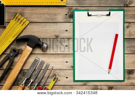 Work Tools For Carpenter And Notepads. Carpentry.