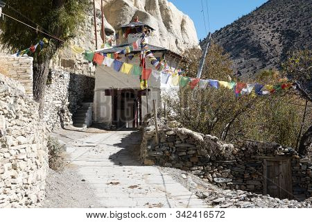 A Buddhist Chorten Stupa Entrance Into The Small Town Of Marpha In The Himalaya Mountains Of Nepal.