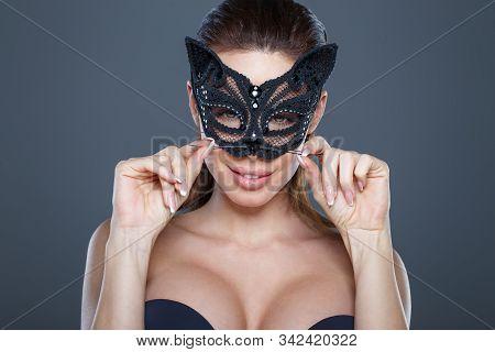 Sexy Brunette Woman Curling Mustache In Catwoman Mask Portrait