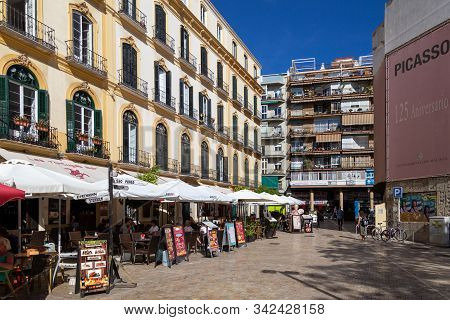 Malaga, Spain - May 23, 2019: Cafes And Restaurant Along Plaza De La Merced, One Of The Main Squares