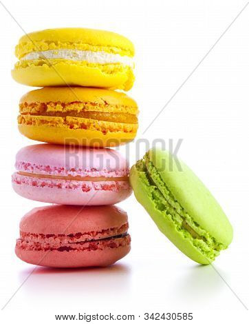 Colourful Macaroons On The White Background. Delicious Macaroons Lined Up In A Row