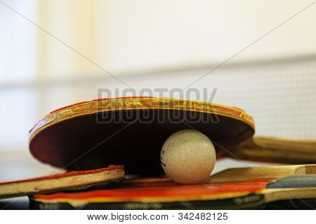 Umea, Norrland Sweden - November 6, 2019: Several Ping Pong Racquet And A Ball On Table