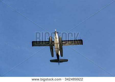 Vancouver, British Columbia, Canada - October 11, 2019: View From Below Of A Seaplane Flying With Bl