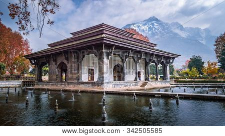 Mughal Heritage Building With Snoe Covered Zabarwan Mountains In The Background During Autumn In Sha
