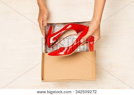 Fashionable Female Shoes In A Box On A Colored Background Top View