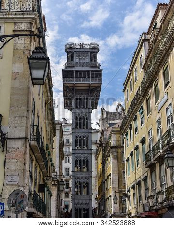 Colorful Buildings And Santa Justa Elevator. Famous Tourist Attraction In Chiado District. Sunny Day